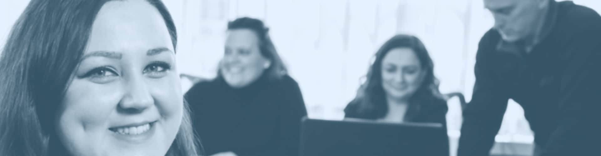 Picture of women in a meeting and smiling